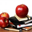 Notebooks, pens and apples on desk — Stock Photo #30156439