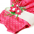 Stock Photo: Pink polka-dot dress with artificial textile flowers