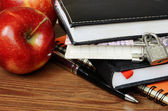 Notebooks, pen and apples — Stock Photo