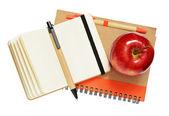 Cuadernos, lápices y manzana — Foto de Stock