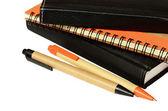 Zeszyty i długopisy — Zdjęcie stockowe