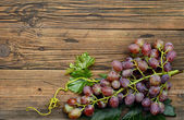 Grapes on wooden table — Stock Photo