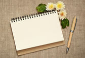Notepad and pen decorated with asters — Stock Photo