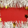 Frame of white tinsel on red background — Stock Photo