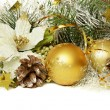 Christmas balls with tinsel, cones and artificial poinsettia — Stock fotografie