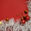 White tinsel and balls on red background — Stock Photo #35678107