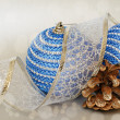Blue christmass balls and pinecone — Stock Photo