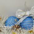 Blue christmass balls, tinsel and pinecones — Stock Photo