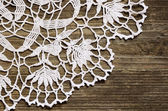 Lace on wood — Stock Photo