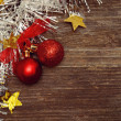 Christmass balls and tinsel on wood — Stock Photo