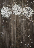 Snowflakes on wooden background — Stock Photo