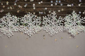 Snowflakes on silver and dark background — Stock Photo