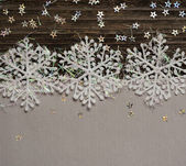 Snowflakes on silver and dark background — Foto Stock