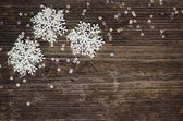 Snowflakes on gray wood — Foto Stock