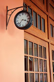 Clock on the wall of a building — Foto de Stock