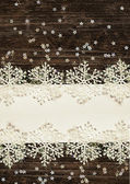 Snowflakes on white and dark background — Stock Photo