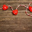 Hearts tied with red ribbon — Stock Photo #38980797