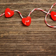 Hearts tied with red ribbon — Stock Photo
