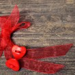 Two hearts tied red ribbon — Stock Photo