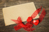 Two hearts tied with red ribbon — Stock Photo