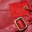 Red leather and a label — Stock Photo