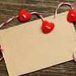 Three hearts and a card — Stock Photo