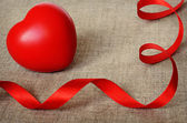 Red heart on gray canvas for Valentine's day — Stock Photo