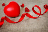 Red hearts on canvas — Stock Photo