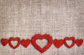 Hearts line on canvas — Stock Photo