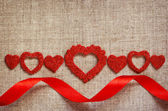 Hearts line and ribbon on canvas — Stock Photo