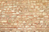 Old weathered red wall of brick — Stock Photo