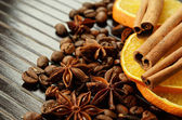 Fragrant spices with dry oranges and coffee — Stock Photo