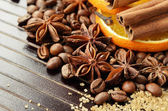 Fragrant spices, coffee, dry orange and reed sugar — Stock Photo