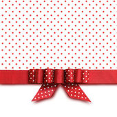 Bow on red and white background — Stock Photo