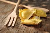 Fresh italian pasta ravioli preparing in a wood background — Stock Photo