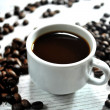 Постер, плакат: Coffee beans and cup of coffee elaboration for brunch hotel time
