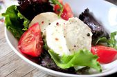 Mozarella cheese salad italian cuisine oil olive and tomatoes lettuces salad dish — Stock Photo