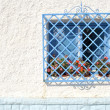 Blue window in seville spain — Stock Photo