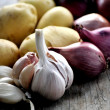 Onions potatoes and garlic ingredients for cooking eat best dish — Stock Photo