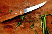 Kniffe cutting Ingredients for cooking a delicious kitchen elaboration meal — Stock Photo