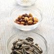 Collage of snack foods includesroastet nuts almonds pumpkind seed — Stock Photo