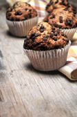 Chocolate muffins in table wood of kitchen — Stock Photo