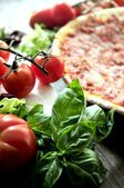 Fresh pizza ingredients tomatoes and basil for italian clasic pizza recipe — Stock Photo