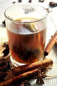 Tea infusion hot drinks with cinammon and anise star aroma — Stock Photo