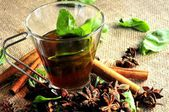 Tea and basil leaf infusion time — Stock Photo