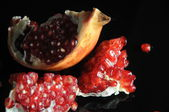 Pomegranates fruit fresh in black background — Stock Photo