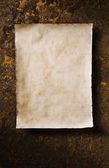 Old parchment on rusty background — Stock Photo