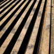 Stacked aged rails — Stock Photo #24498637