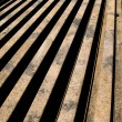 Stacked aged rails - Stock Photo