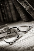 Antique spectacles for an old reader — Stock Photo
